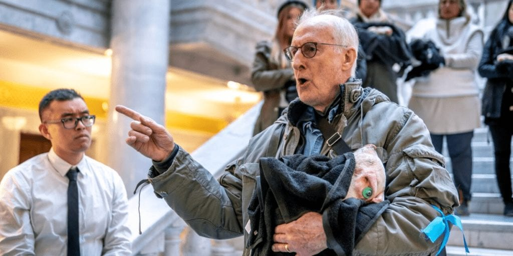 Actor James Cromwell Storms Utah Capitol Building Holding Dead Piglet In Animal Cruelty Protest