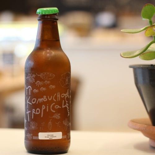 A bottle of vegan drink kombucha on a table