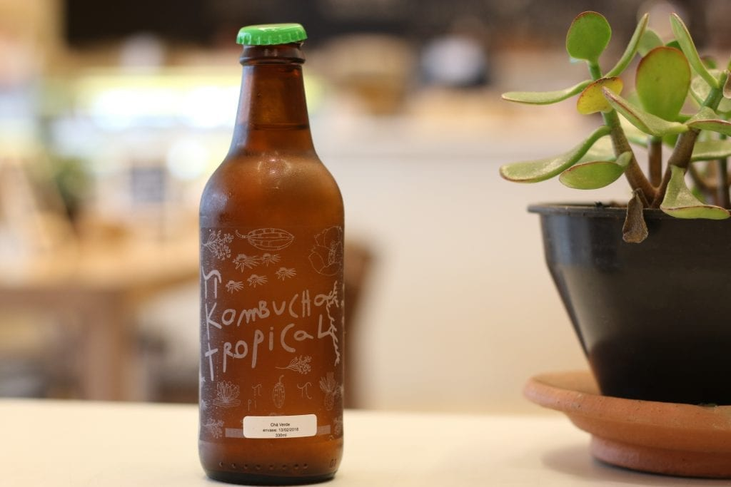 A bottle of vegan beverage kombucha on a table