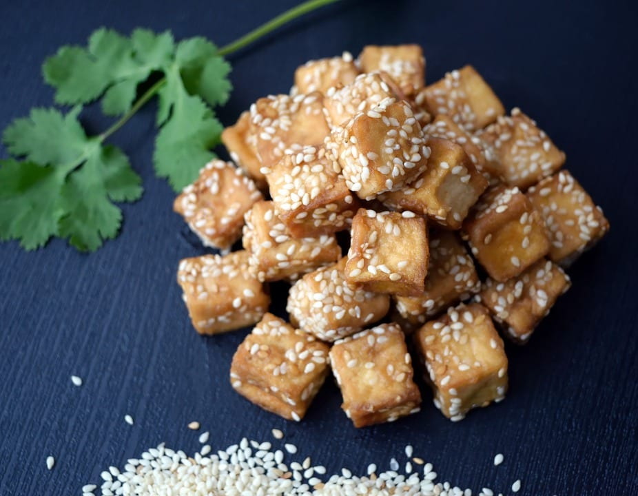 Vegan dish made with fried tofu and sesame seeds.
