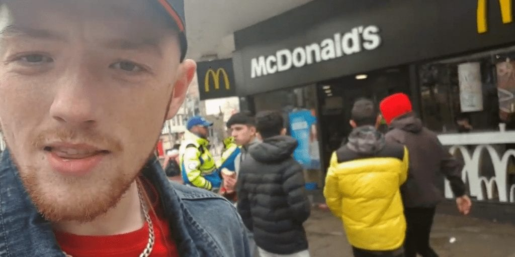 McDonald's customers confront vegan activist and munch burgers in his face
