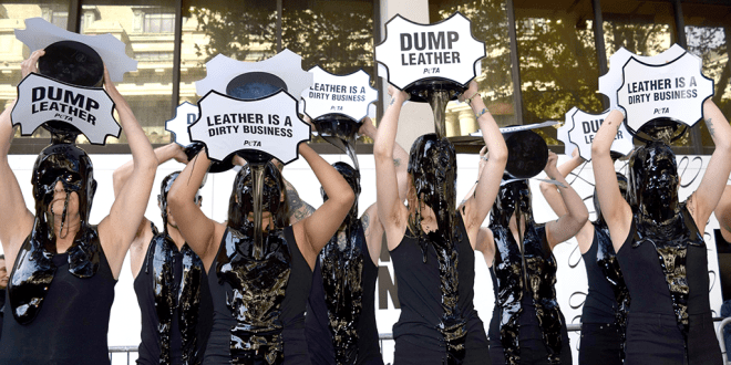 Activists pour 'toxic slime' over their heads to protest leather use at London Fashion Week